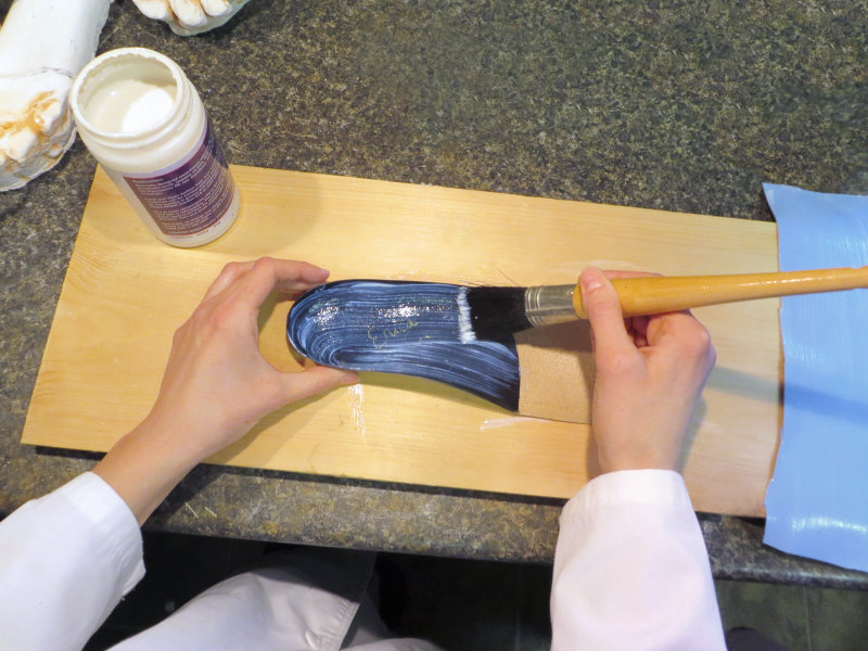 Glue is applied to both the orthotic and the poron. (Custom foot orthotic fabrication process, step 15.)